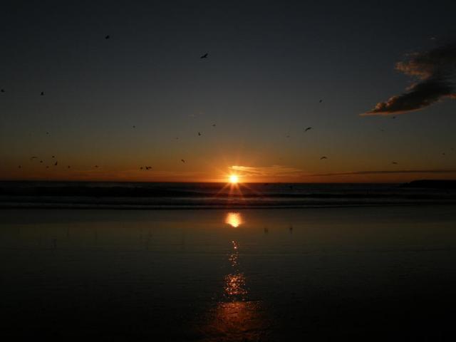 Португалия, Коста да Капарика. Закат над океаном.